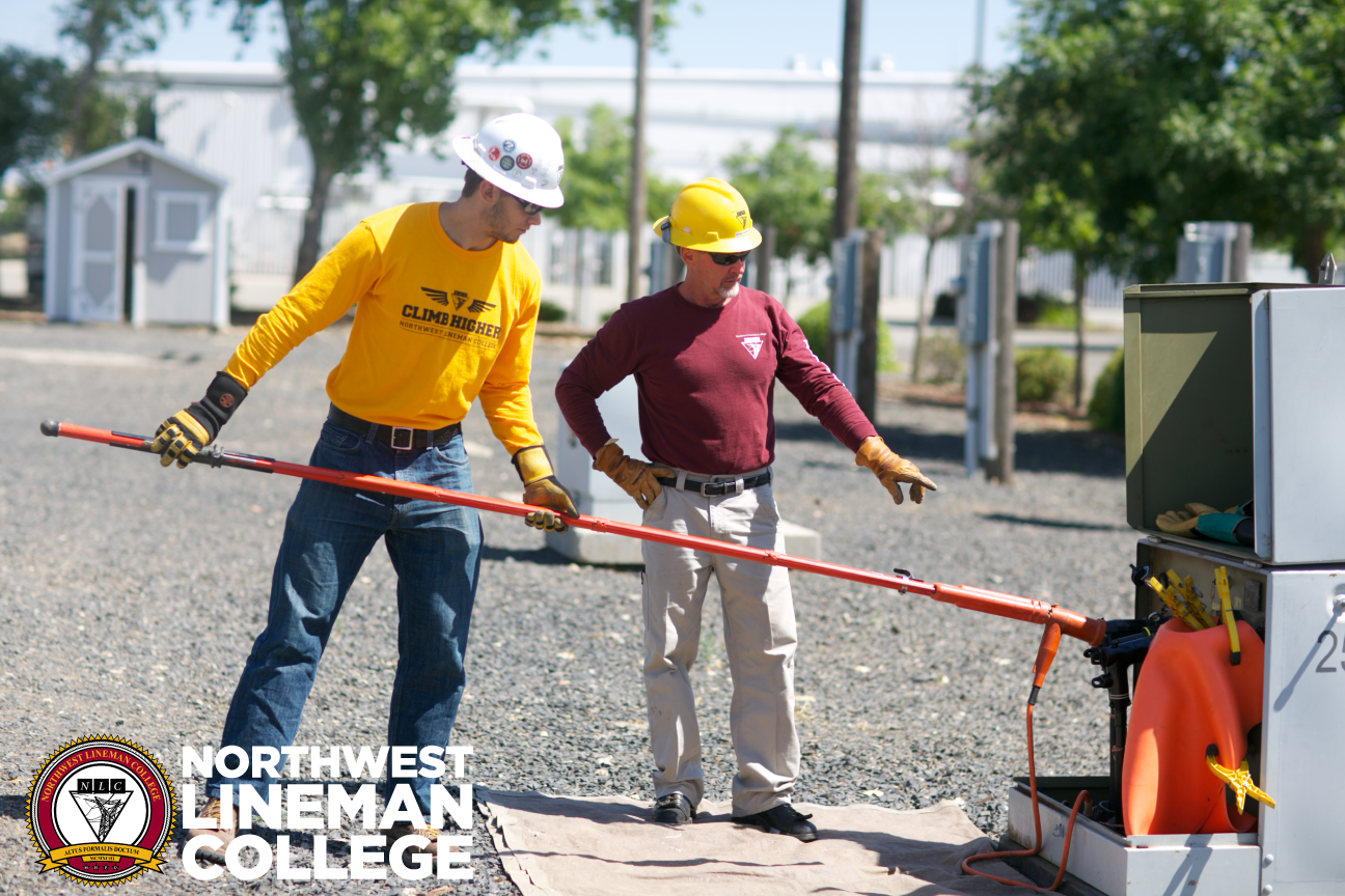 Electrical Lineworker Program Student Receiving Instruction On How Underground Service Cable To Ground A Primary Lineman Linework