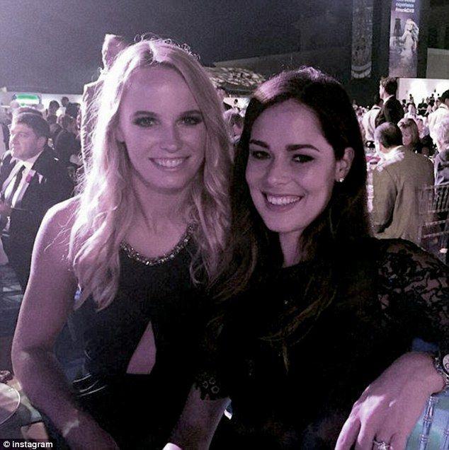 Caroline Wozniacki and Ana Ivanovic pose as they watch American popstar Katy Perry do her thing in Dubai