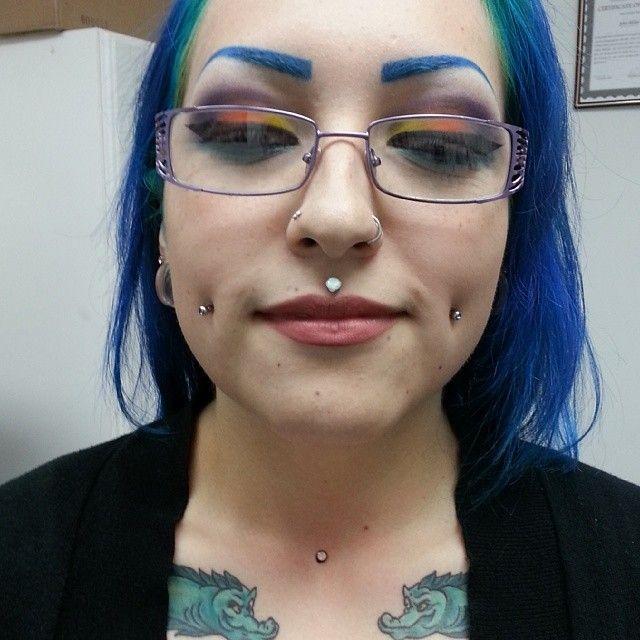 Medussa piercing, cheek piercing, multiple nose piercings ...