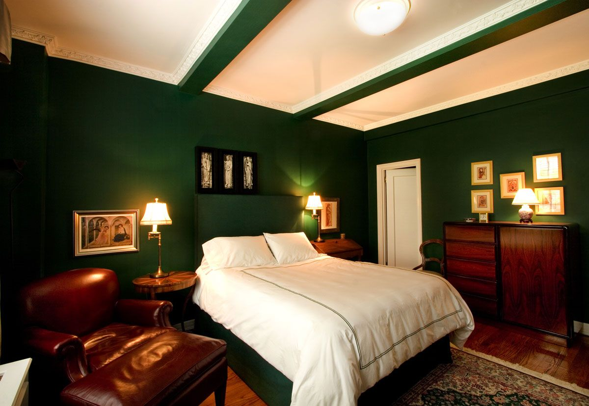 bedroom color Bold design with dark green wall and brown wood  furniture