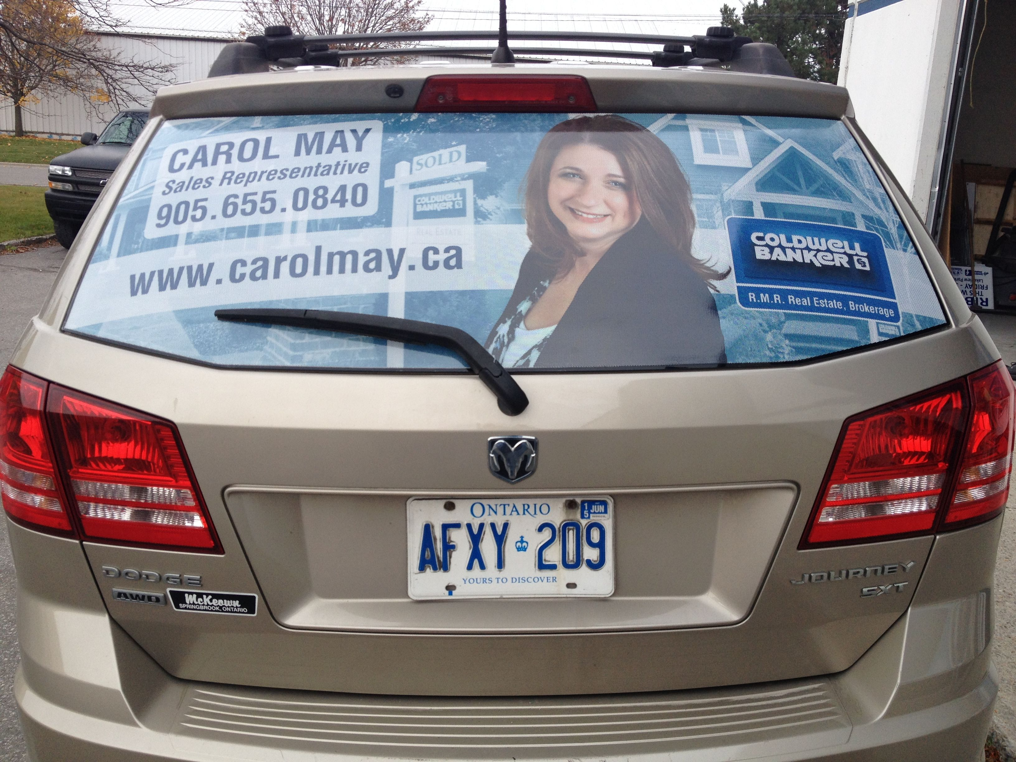 Great new rear window perforated vinyl graphics completed for carol may of coldwell banker r m r real