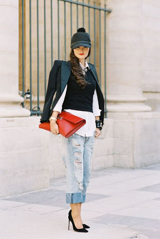 Distressed boyfriend jeans paired with pumps and a clutch make this fashion week outfit effortless and edgy.