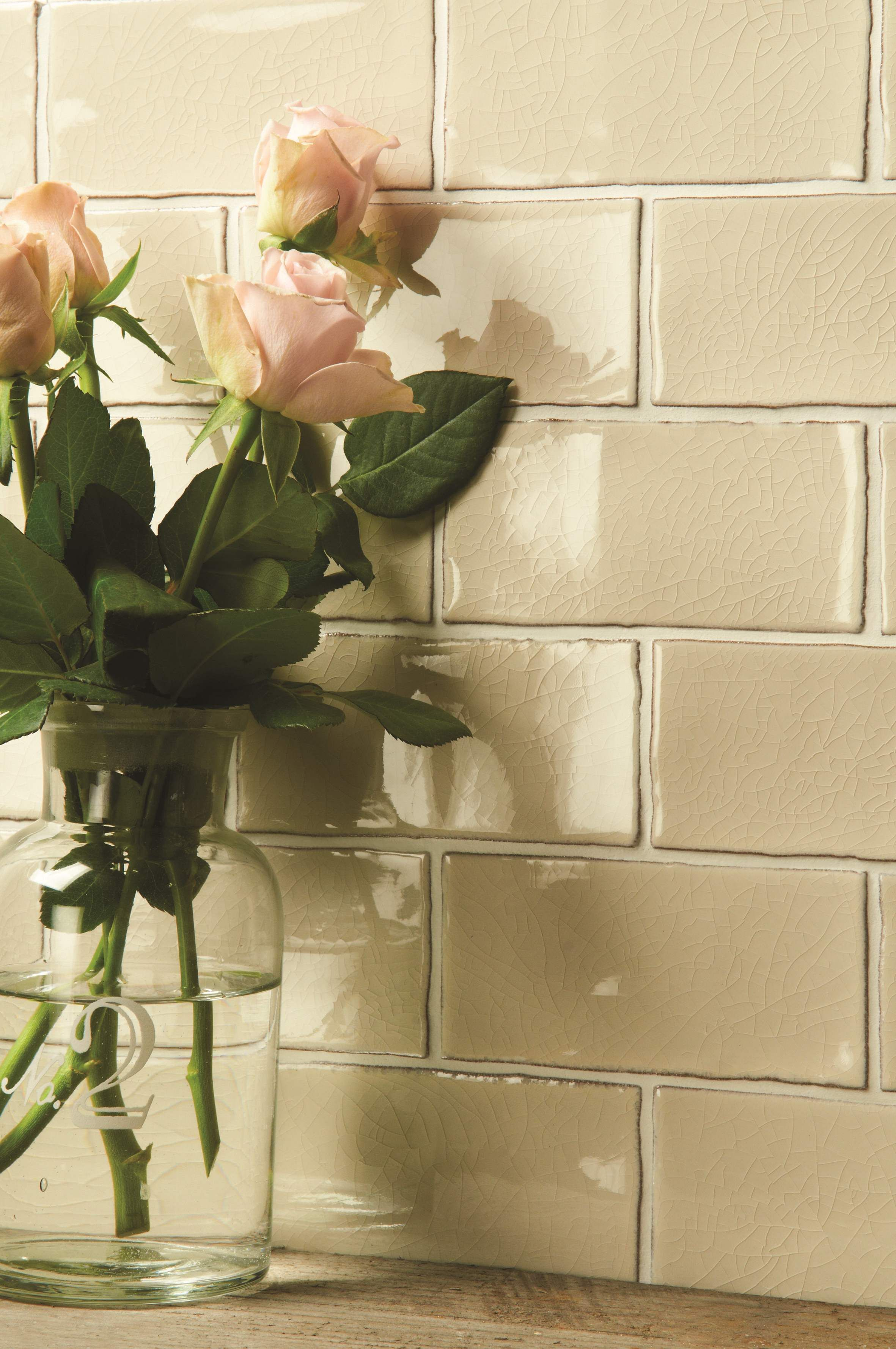 The muted colour and crazed texture of these Dune half tiles look  beautiful. Handmade ceramic