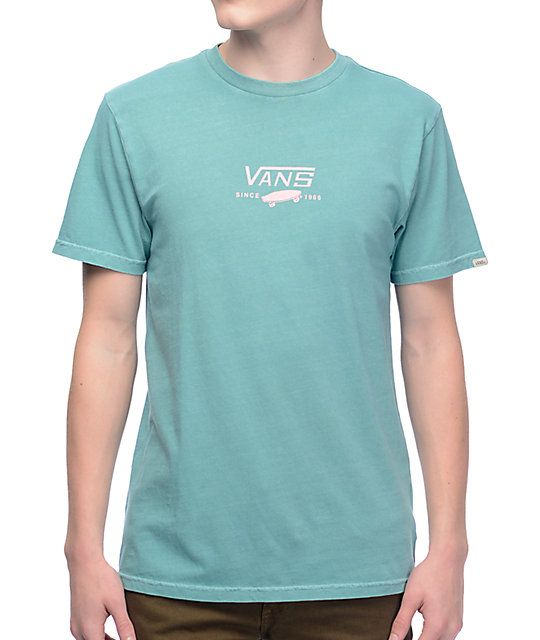 2bb29177a2ea For a simple yet classic Vans look reach for the Canton 90's shirt from Vans.  A teal pigmented tee with the Vans iconic logo in pastel pink is featured  on ...