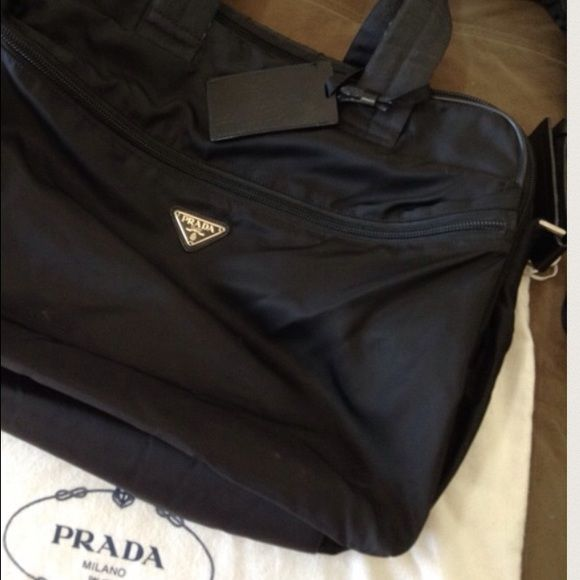 88d7ee32f7d1dd ... buy black prada weekender bag. one front zipper which contains a small  name tag that