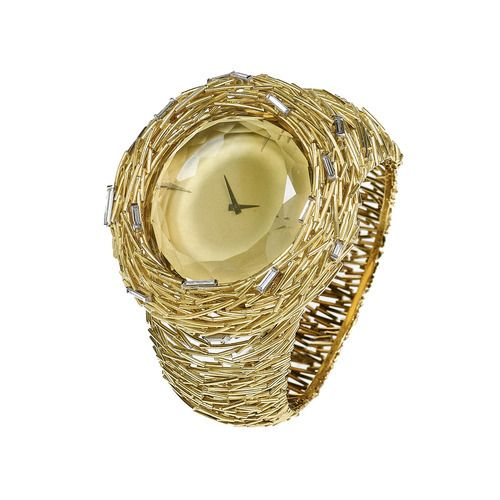 """From Andrew Grima's """"About Time"""" collection for Omega. Yellow Gold """"matchsticks"""" set with an oval-cut Citrine and baguette-cut Diamonds"""
