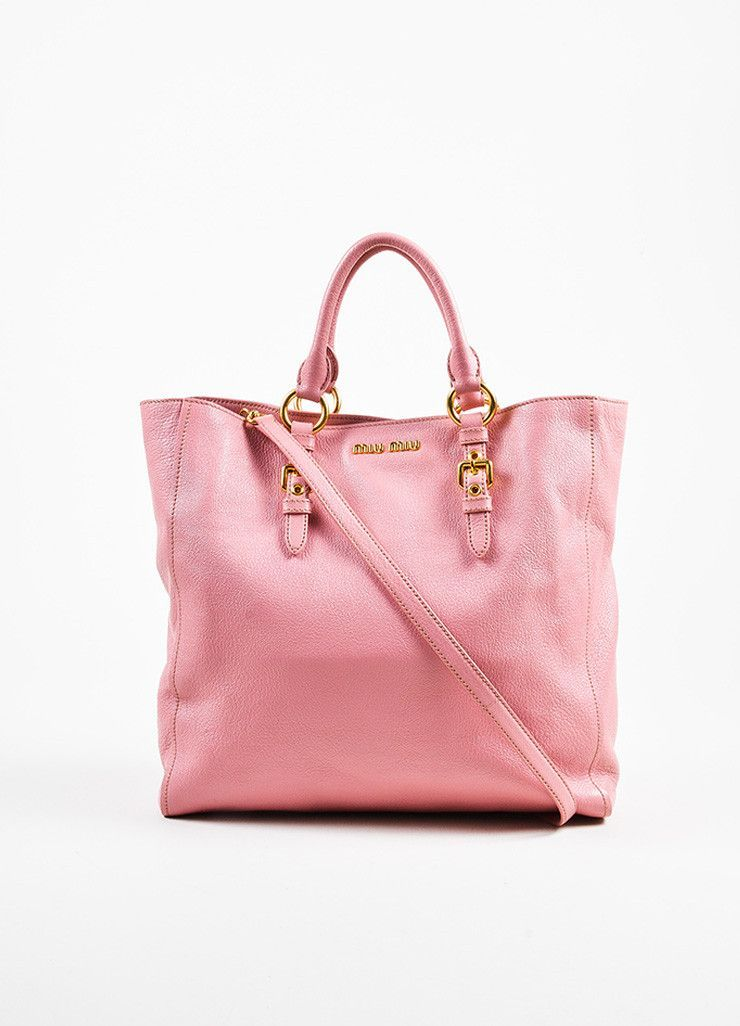 7648c2fa09 ... pink tote bag. Constructed of grain leather. Small gold-tone logo at  top opening. Gold-tone hardware. Double top handles. Detachable shoulder  strap.