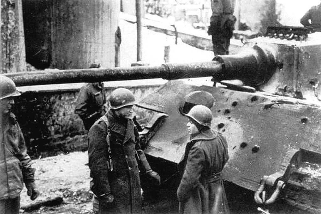 Tiger II showing at least nine hits on frontal armor, none of which appear to have penetrated.