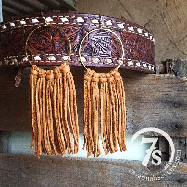 """Long feather necklace Serape feather with leather trim and back Turquoise stones Bronze pearls Dark brown leather ties and fringe 36"""" long Handcrafted in Texas"""