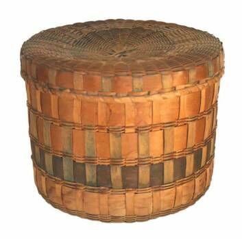 A very nice lidded Woodlands  Indian basket,  woven free hand without a mold using hand-cut splints, some swabbed in Prussian blue, probably ca. 1880 with nice vegetable dye accents.