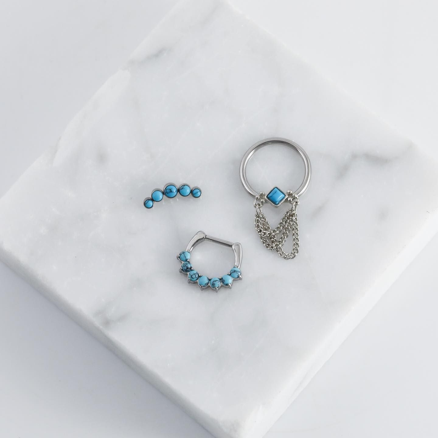Buy 2 items and get the 3rd FREE today thru the 30th at 11:59pm cst on out site! There's NO LIMIT ❤ This set would be perfect for a septum, conch, and helix piercing!⠀ .⠀ SHOP: www.spiritadornments.com⠀ .⠀ .⠀ .⠀ .⠀ .⠀ #piercingjewelry #piercingjewellery #Bodyjewelry #piercings #septumpiercing #septumjewelry #septumring #daithpiercing #conchpiercing #turquoise #turquoisepiercing #turquoiselove