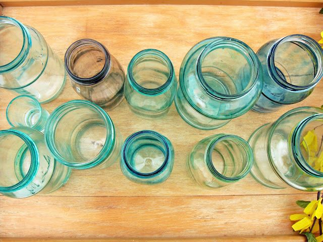 1 tsp elmers glue, 3 drops food coloring, and 1.5 tsp of water. painted onto clear glass jars will turn them whatever color you'd like