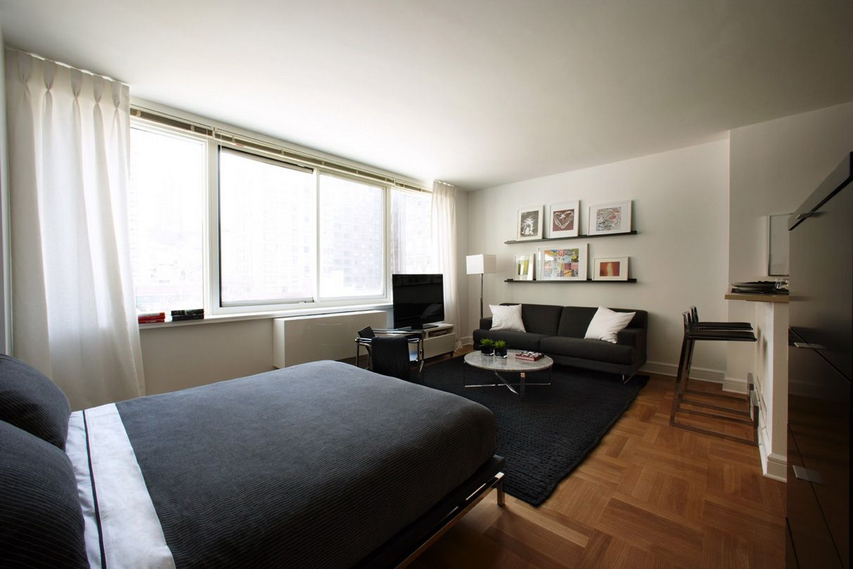 Studio Furniture Ideas Part - 23: Small Studio Apartment Decorating Ideas With White Curtain Also Big Glass  Windows With Black Covering Bed Also Black Comfort Sofa Design