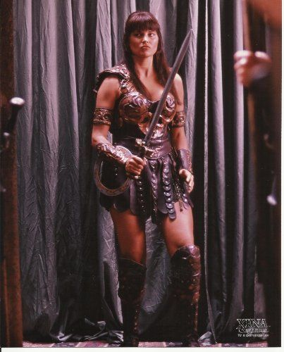 Xena Warrior Princess Lucy Lawless 8 x 10 Inch Photo standing on stage in costume