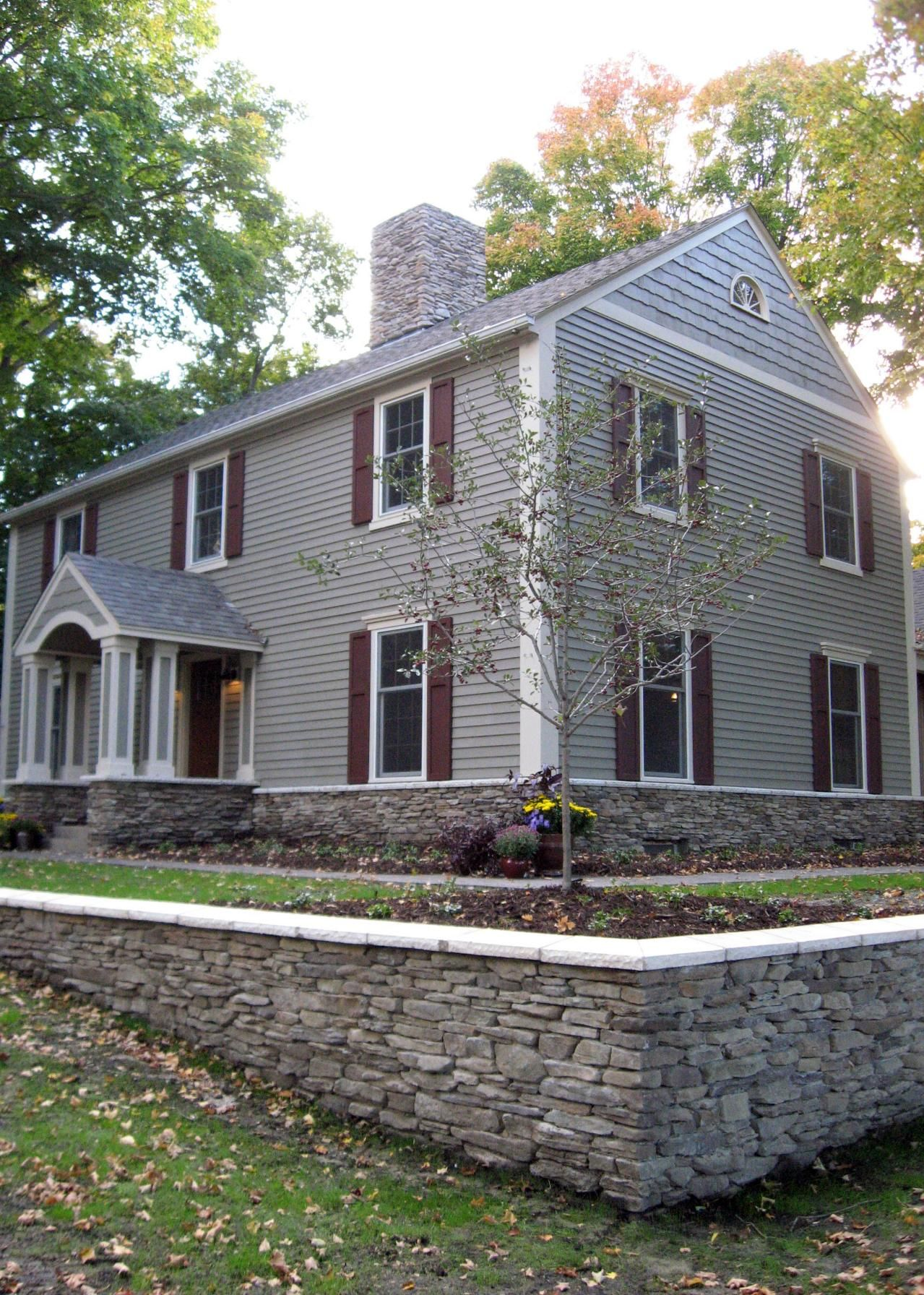 Gray Stone With Maroon Shutters Gray Colonial Home With