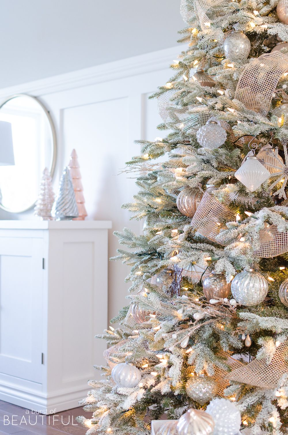 A Snowy Flocked Christmas Tree | Cheer, Decorating and Rose