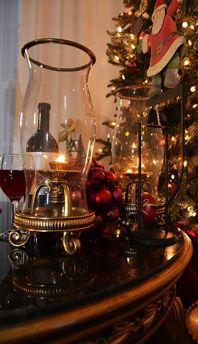 holiday decor with hurricane lamps decorating for the holidays with candles christmas decorating