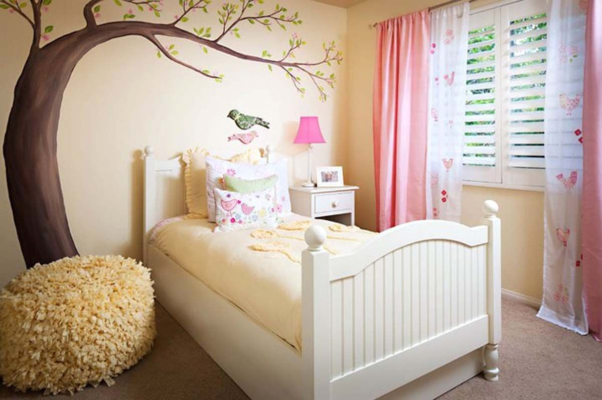 This girls room is decorated in pale yellow with birds and ...