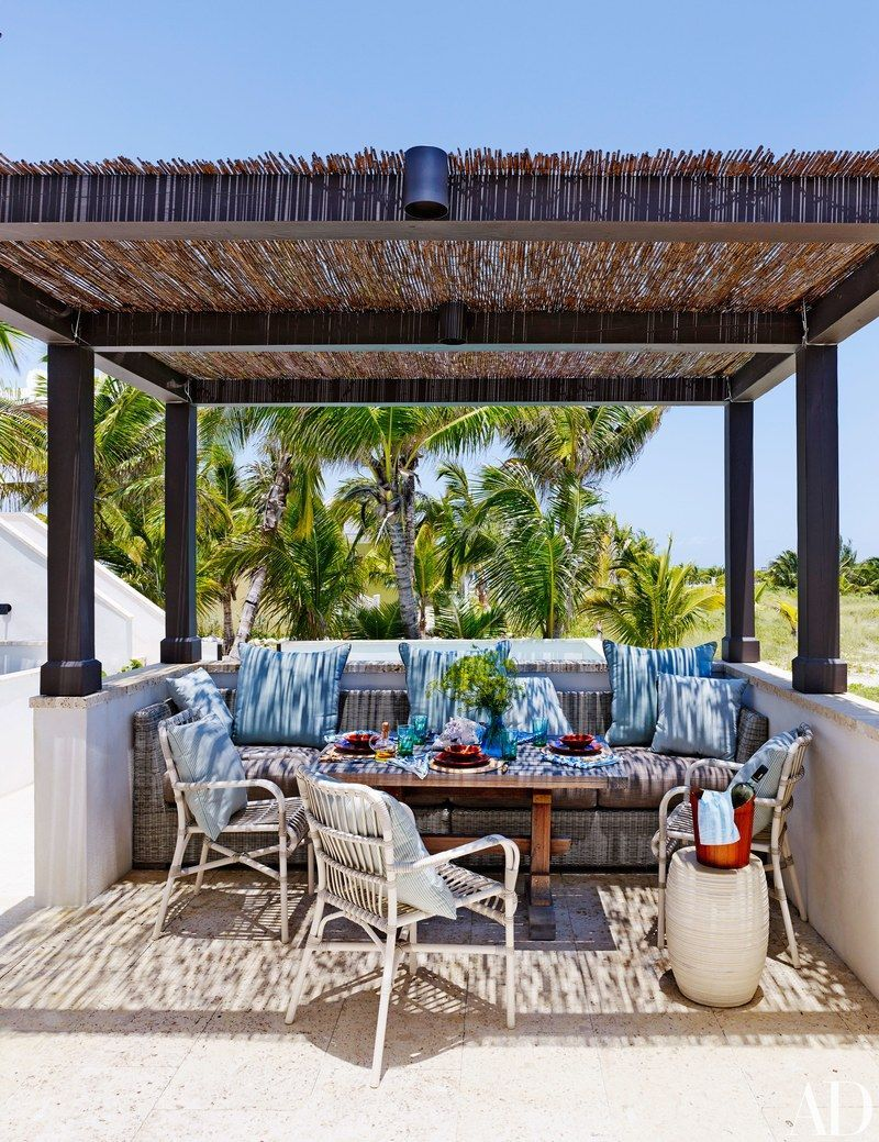 Scheerer Roofed The Pergola With Bamboo Fencing From Walmart The Stacking Armchairs Are By Janus Et Cie And Pergola Backyard Pergola Pergola Attached To House