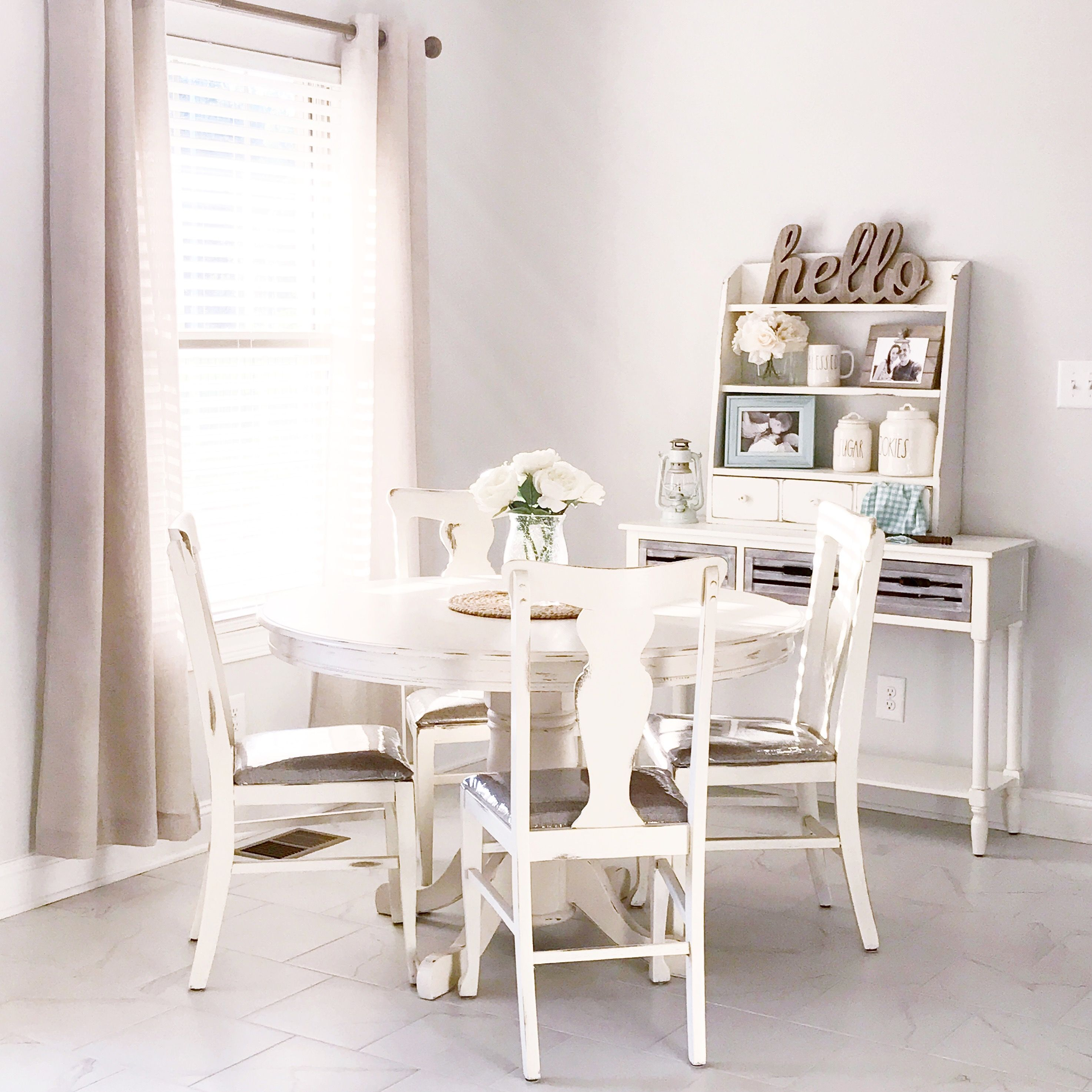 A farmhouse style pedestal table and antique chairs in my