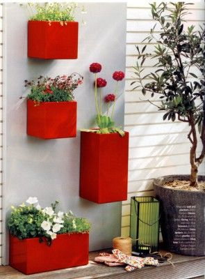 wall mounted planter boxes; great space saving idea for apt dwellers, like myself! Plus adds pizazz to a naked wall!