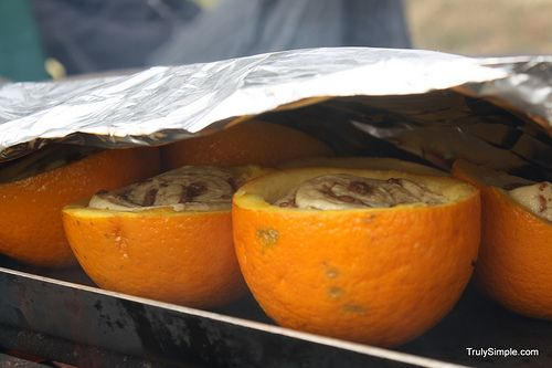Orange rolls cooked in oranges over a fire!