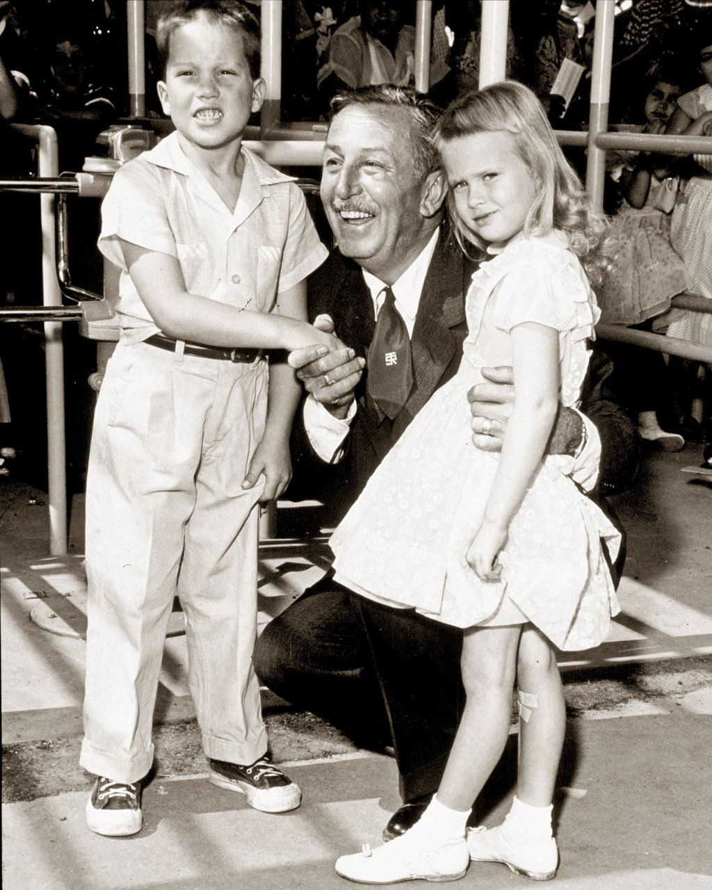 Walt with the very first guests at Disneyland!