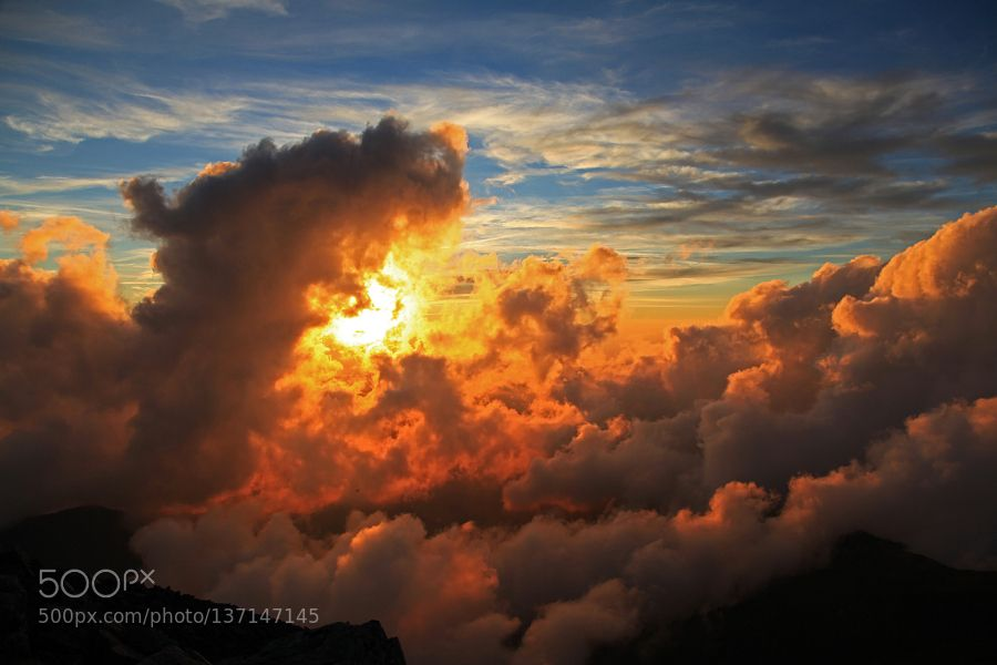 Golden Clouds over Mountains by JinYoshida