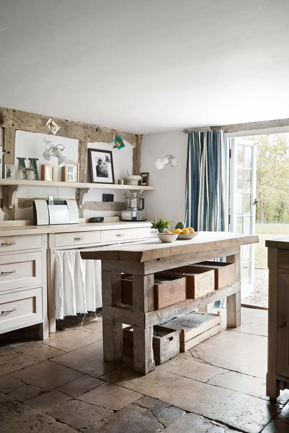 An ancient Sussex farmhouse filled with inherited furniture and flea-market finds