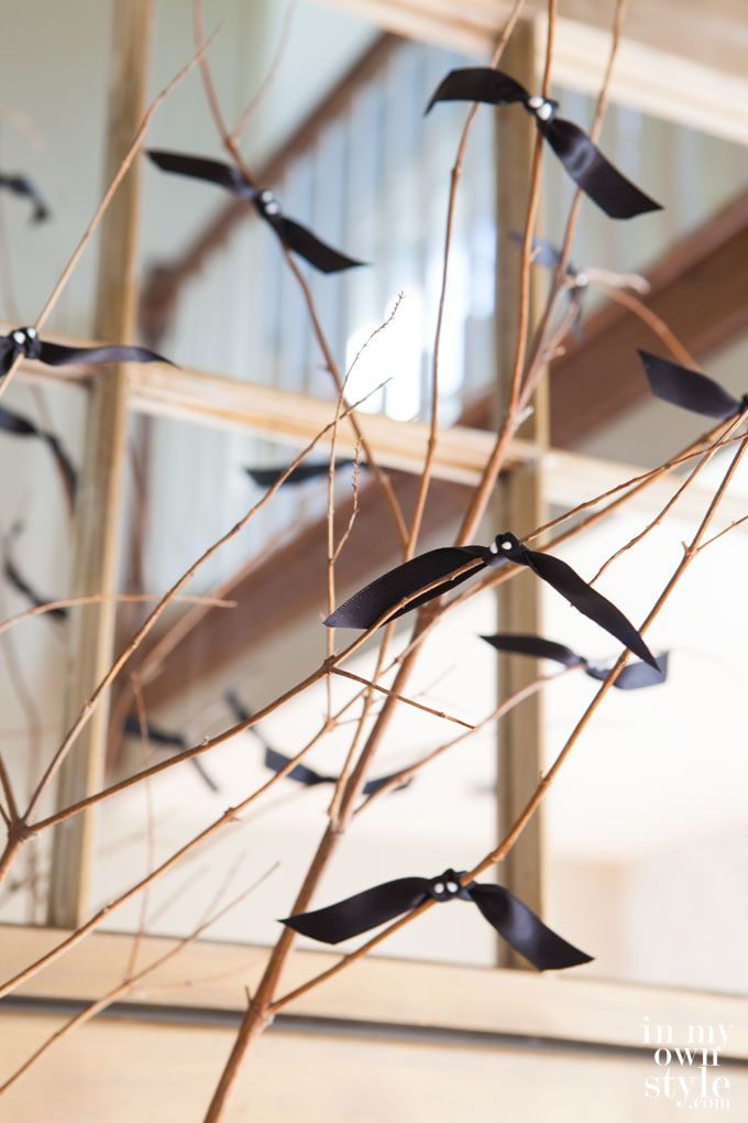 Ribbon tied to sticks to create bats! Easy-Halloween-Decorating - create halloween decorations