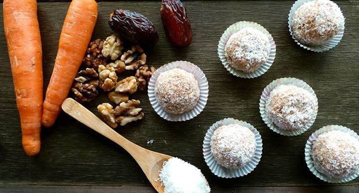 3 large, organic carrots 2 Tablespoons date syrup or honey 1/2 teaspoon vanilla extract 1 teaspoon virgin coconut oil 1/4 cup unsweetened, shredded coconut  1/2 cup walnuts, finely blended 30-40 secs  4-5 large medjool dates (soaked them in warm water 15-20 min ) 1/2 cup oatmeal Start with the carrots by adding them in the Slow juicer robot. Enjoy the fresh juice, then place the carrot pulp in a medium sized bowl. Add the remaining ingredients to the pulp (except shredded coconut), squas