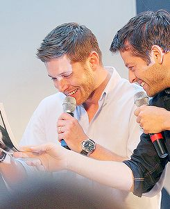 jensen ackles and misha collins laughing over misha s old resume