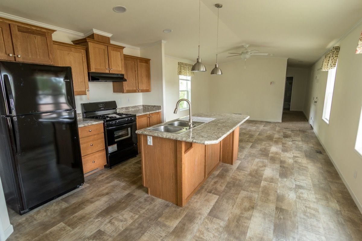 Kitchen with Island in a mobile home for sale in Hillcrest ...