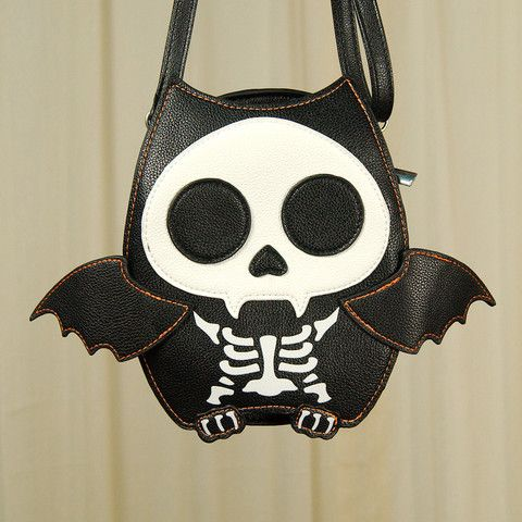 Skeleton Bat Crossbody Bag:Add a little creepy cute with this skeleton bat crossbody bag. The bat is black and white with orange stitched details and cute little wings. The interior is lined in black fabric, has a slot pocket on either side, has a 54 inch black vinyl strap is adjustable and detachable, and the back has a outside slot pocket. Crossbody bag... $26.00
