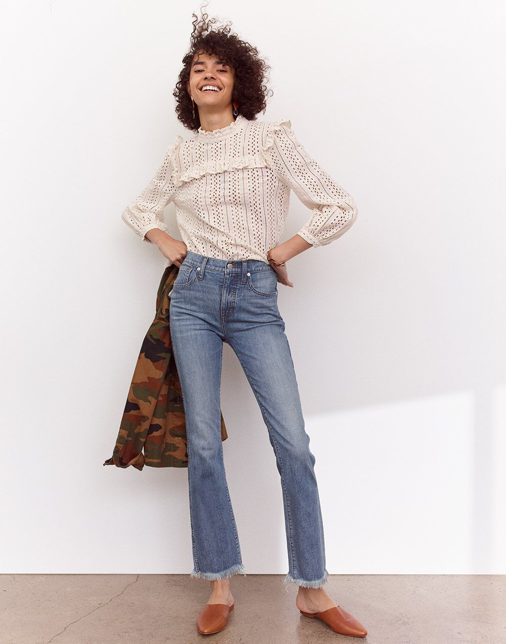 6659636b15 madewell cali demi-boot jeans  eco edition worn with eyelet mockneck ruffle  top