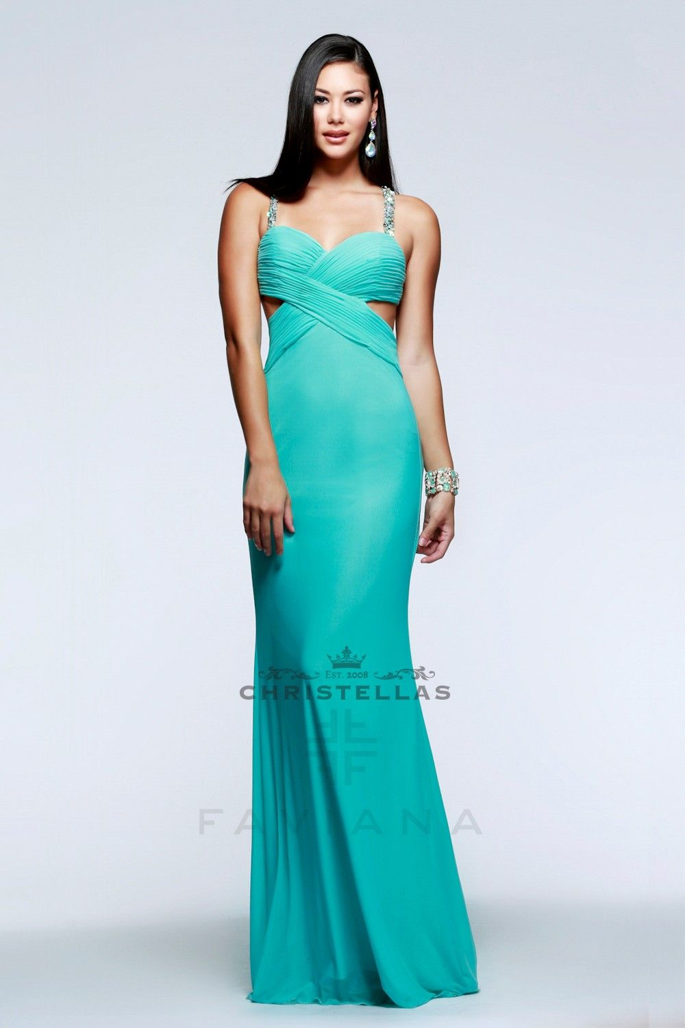 The uniquely strappy and sequined back on this dress is dazzling ...