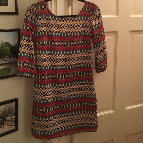 3/4 sleeve Anthropologie like dress worn 2x size 4 3/4 sleeve Anthropologie like dress worn 2x size 4. It could really be a 2-4. Zipper works. It looks great with boots ... Flip flops... Closed toe. 100% Polyester. I have so many of this style I am trying to cut down what I have J. Crew Dresses