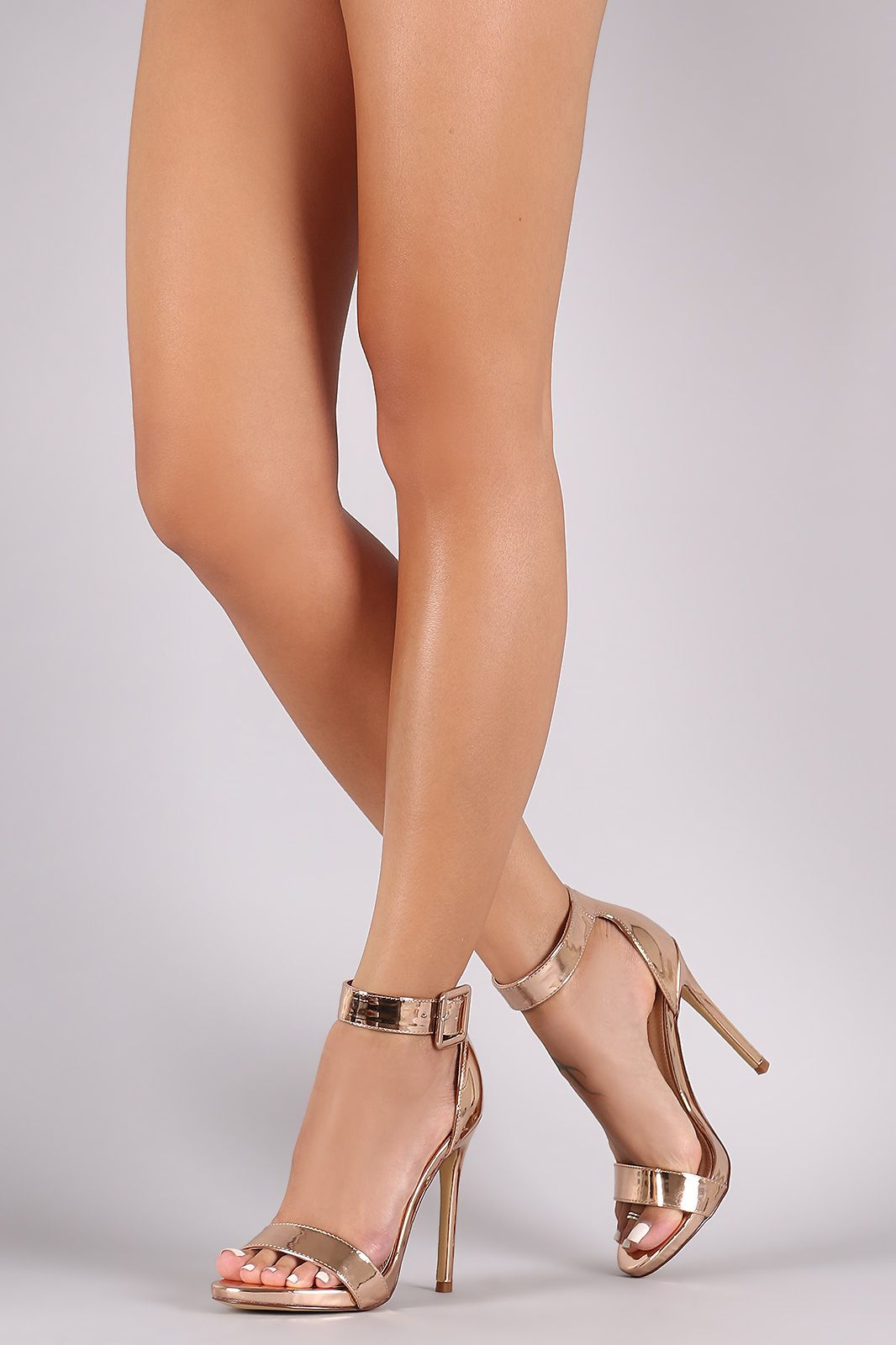 73574be2ea3 Shop Metallic Buckled Ankle Strap Stiletto Heel. This heel features an open  toe
