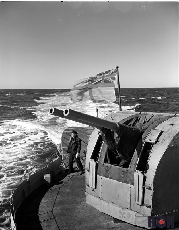 After gun platform of HMCS Iroquois with Officer of the quarters Lieut. Jim Saks RCNVR of Edmonton