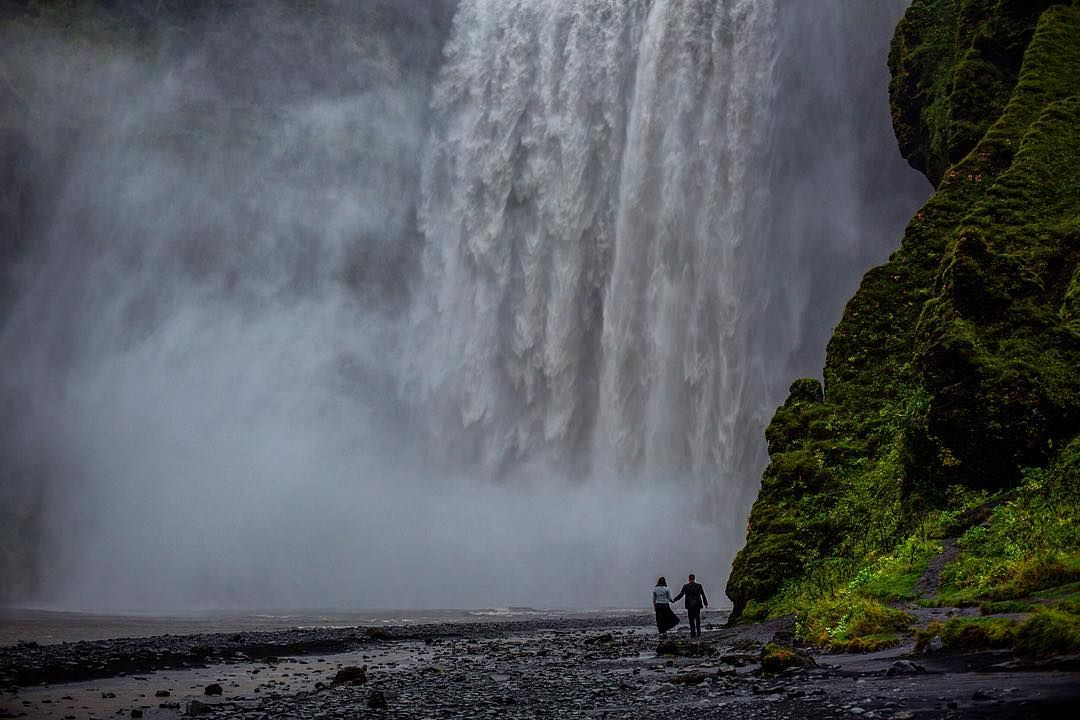 Skogafoss Iceland. I want to go back.  #iceland #destinationweddingphotographer #icelandphotographer #waterfall #elope #elopement #elopementphotographer #icelandelopement #travel #beautiful #awe #wet #rain #mist #littlepeoplebigworld #epic #weddison #wedaward #wedding #yegphotographer