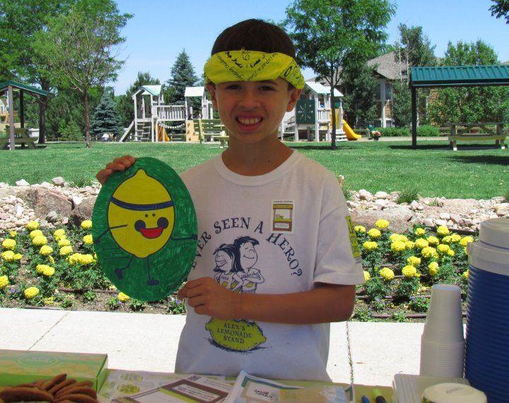 Running Lemon with childhood cancer hero, Michael at his Lemonade Stand!