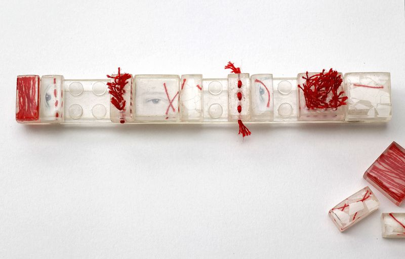 Dania Chelminsky - DeconstructedBars - Brooch - base + replaceable parts 12.5 x 1.5 x 1cm , epoxy, silver, threads, photos, eggshells