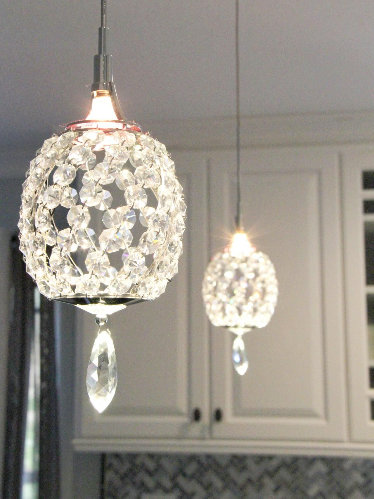 Crystal Pendant Lights Over A Peninsula Bring A Touch Of Glam To