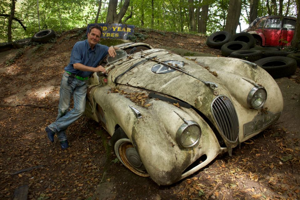 Artist collected FIFTY vintage cars and left them to rot in a forest ...