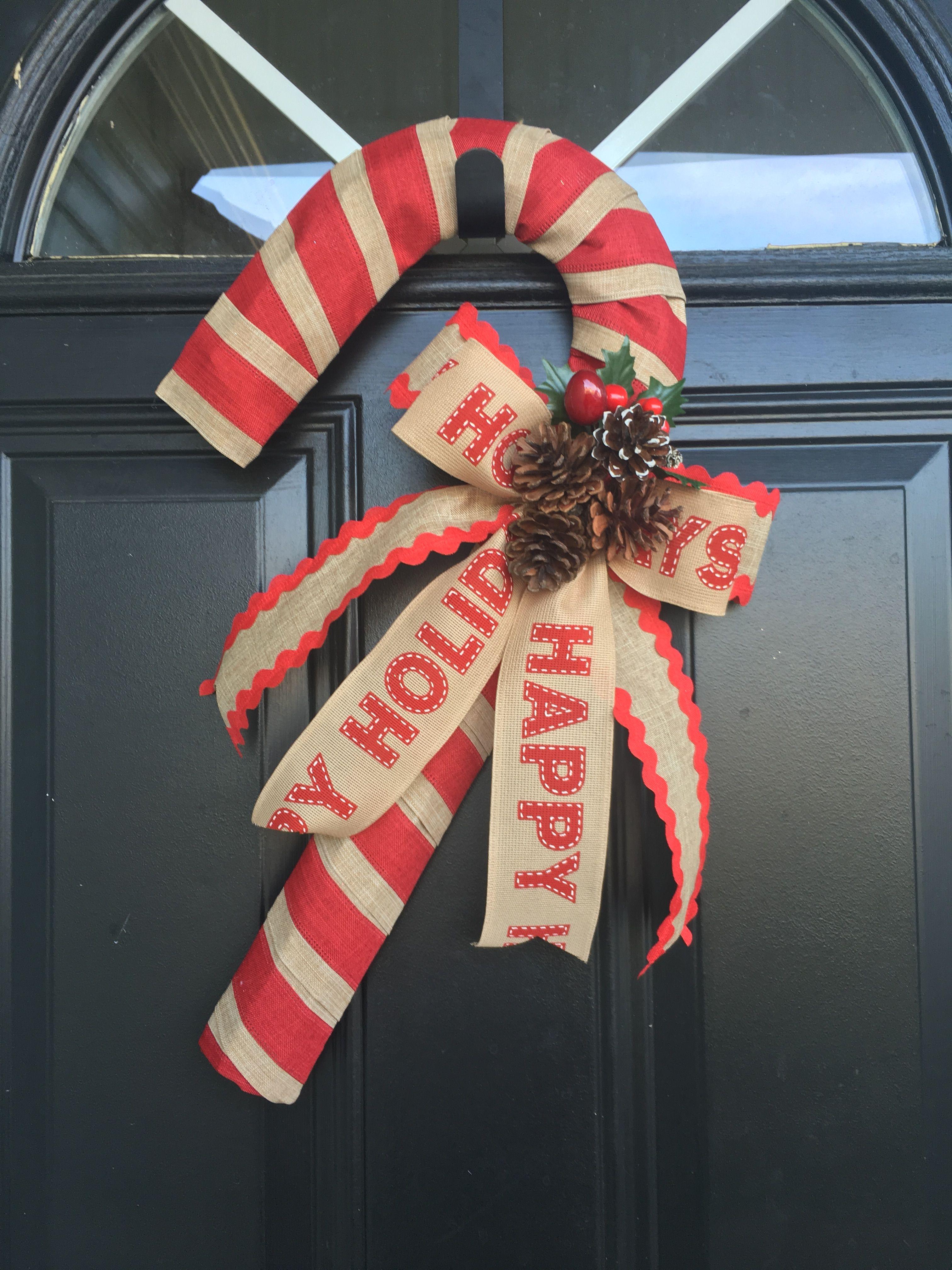 Candy cane shaped wreath. #christmas #ChristmasDecor #ChristmasWreath #candycane #createyboutique   Candy cane wreath. Holiday wreaths. Christmas ...