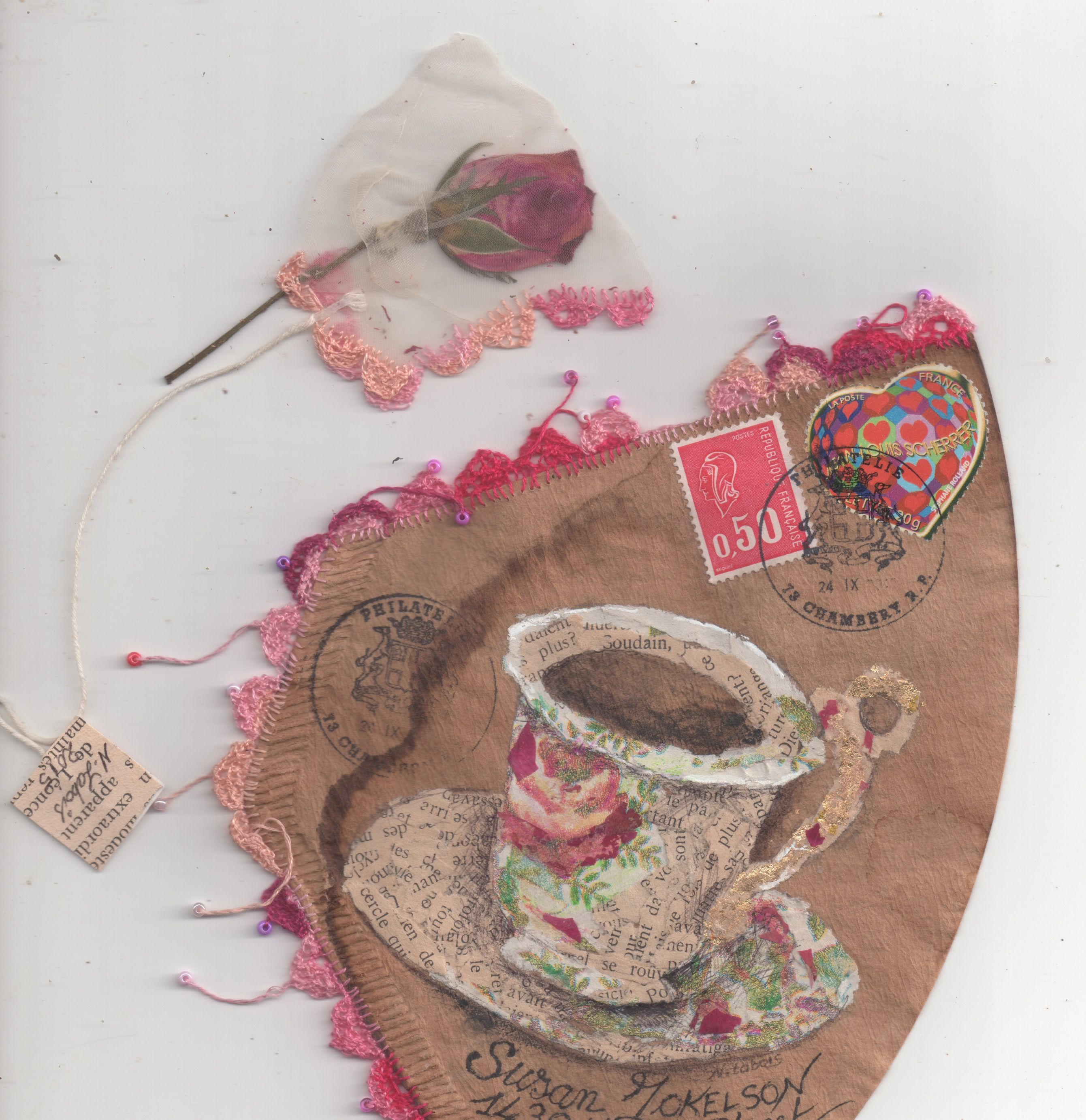 """Clever Nathalie Labois-DeBesson uses coffee filters as sort of envelope on which she collages.  Inside the filter was this """"tea bag"""" containing a rosebud.  How cool is that?!"""
