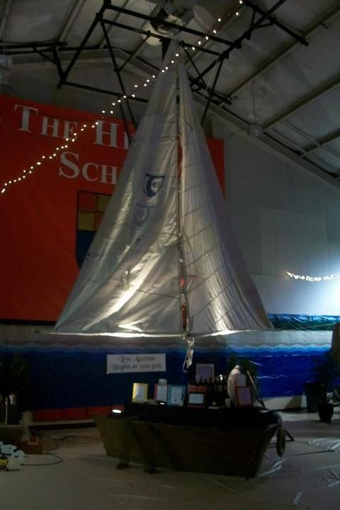 A real sail from a sail boat, engineered to cover the basketball goal in this school gym.  Gorgeous for a pirate theme!