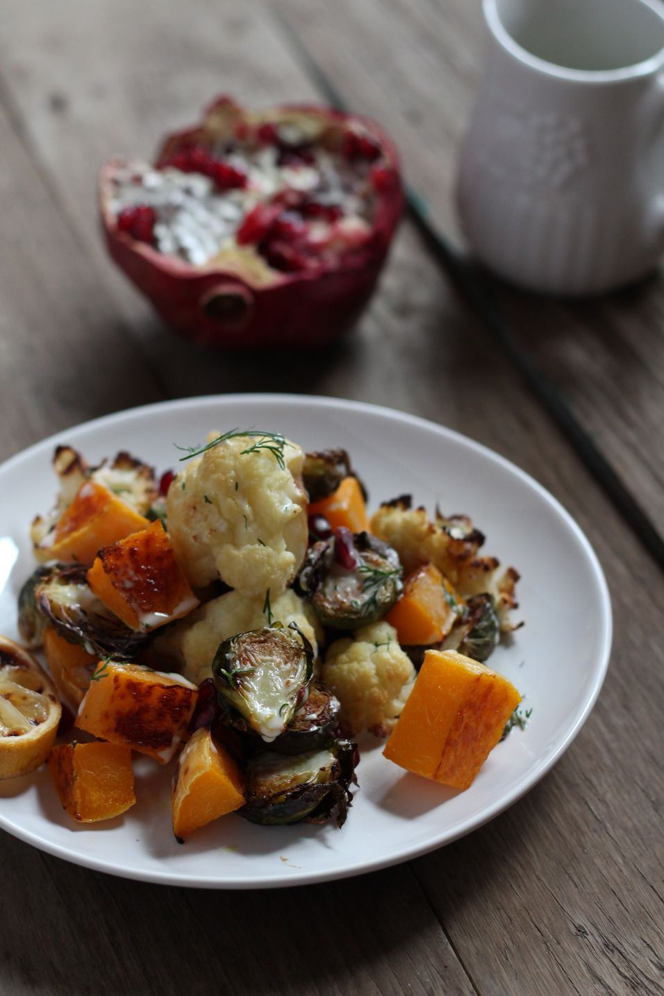 Roasted Vegetable Salad with pomegranates and horseradish dill dressing