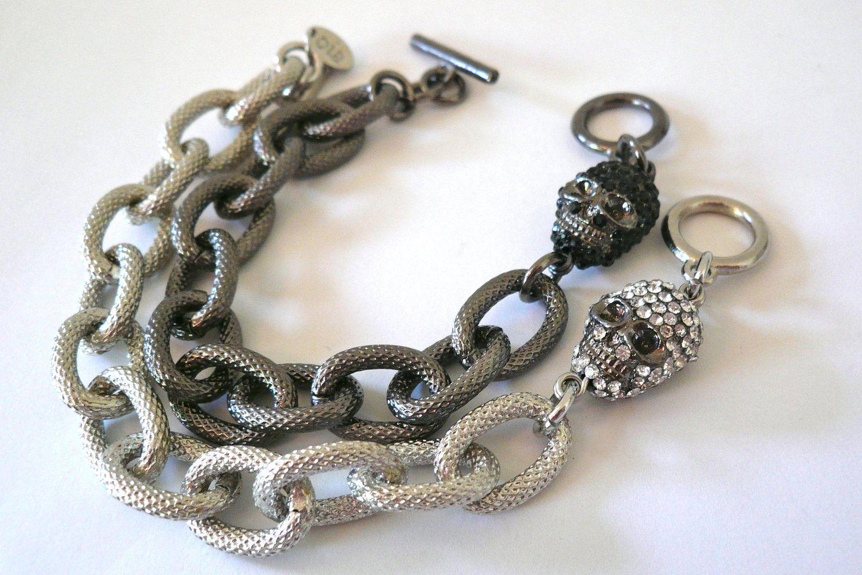 Textured gunmetal link bracelet with black pave skull charm. $30.00, via Etsy.