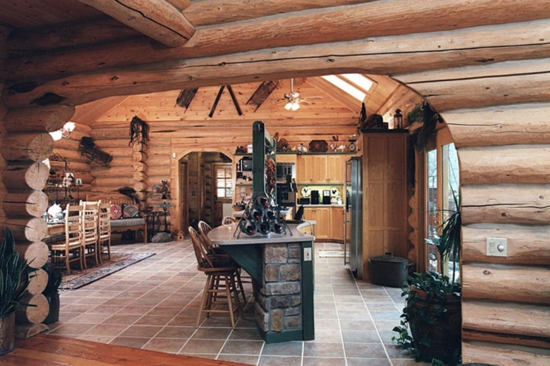 Log house kitchen with stone tile work